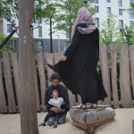 Family using play area East Village